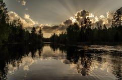 River landscape and sunset. Sunset shot at river jyräänjoki, location paaskoski, Kouvola, Finland. Beautiful sky and clouds Stock Photo