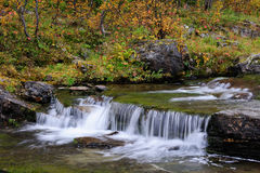 River landscape with waterfall  in autumn, flatruet, sweden Royalty Free Stock Image