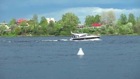 River landscape with yacht stock video footage