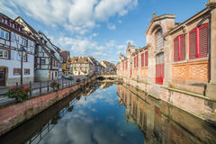 River Lauch and Little Venice in Colmar. COLMAR, FRANCE - 30TH JULY 2016: A view of colourful timber framed buildings and part of Marché couvert de Colmar in Royalty Free Stock Photos