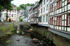 The river Laufenbach flows straight through small city Monschau in Germany Stock Photography