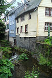 The river Laufenbach flows straight through small city Monschau in Germany Stock Images