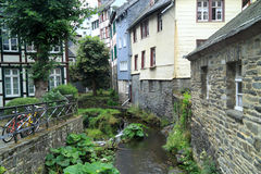 The river Laufenbach flows straight through small city Monschau in Germany Royalty Free Stock Image