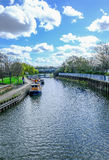 River Lea at Bow with longboats moored. A springtime shot royalty free stock image