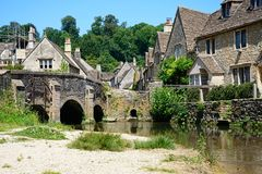 River leading to village, Castle Combe. Royalty Free Stock Image