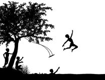 River leap. Editable vector silhouette of young boys leaping off a tree swing into a lake or river Stock Image
