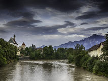 River Lech in Fussen with historic church and alps Royalty Free Stock Images