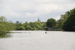 River Lee in Cork Ireland with canoeist. Paddling down the river Royalty Free Stock Photo