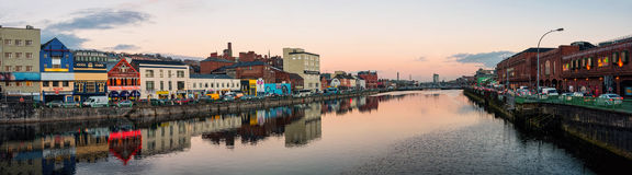 River Lee in Cork, Ireland. Panoramic view of River Lee quays in Cork, Ireland in the city center with many restaurants, shops, bars and car traffic Stock Photos