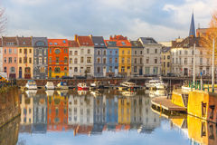River Leie, colored houses and Belfry tower in Royalty Free Stock Photos