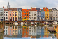 River Leie, colored houses and Belfry tower in Stock Photo