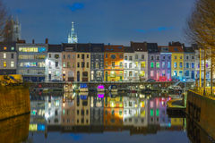 River Leie, colored houses and Belfry tower in Royalty Free Stock Image