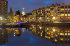 River Leie, colored houses and Belfry tower in Royalty Free Stock Images