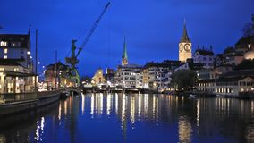 River Limmat  in the centre of Zurich in the evening stock video footage