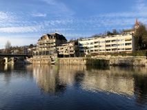 The river Limmat with a promenade in the city of Zurich stock image