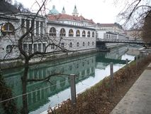 River Ljubljanica. Pretty canal with green water of river Ljubljanica flowing through Ljubljana, Slovenia Royalty Free Stock Photo