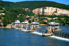 Rhone River Boat Locks. Boat locks on Rhone river in French countryside with limestone cliffs in background Stock Photo