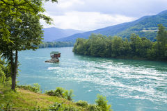 River with a lonely house on a rock on a summer day in mountains. River Drina is Serbia with a lonely house on a rock on a summer day in mountains royalty free stock images