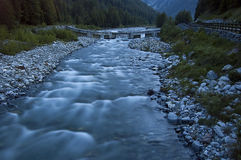River, long time exposure. Mountain river at dusk taken with long exposure time stock photo