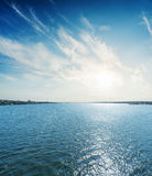 River and low sun in clouds Royalty Free Stock Photo