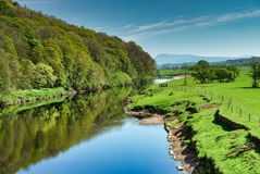 The River Lune near Lancaster flowing through lush green country Royalty Free Stock Images