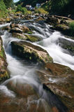 River Lyn - Exmoor National Park. This was shot with a long exposure in the afternoon. In the background you can see the houses of Lynmouth royalty free stock image