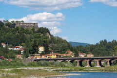 The River Magra at Aulla, with Brunella Fortress landmark. Stock Images