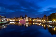 River and Main Town in Gdansk at dusk. Scenic view of the Motlawa River and lit old buildings on the Long Bridge waterfront at the Main Town Old Town in Gdansk Royalty Free Stock Images