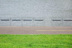 River, meadow, road, and baluster. Background of the river with road Royalty Free Stock Photography