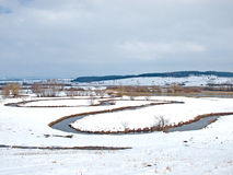 River meandering through a field Stock Photo
