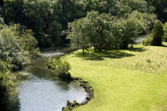 A river meandering through the trees Stock Photo