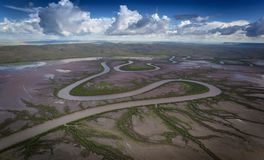 River Meanders across the tidal marshes near Wyndham in the Kimberley. Fancy a swim on the wild side. Tidal crocodile infested rivers near Wyndham in Western stock photography