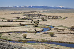 River meanders in North Park, Colorado. Illinois River meanders through Arapaho National Wildlife Refuge, North Park near Walden, Colorado, early spring scenery Stock Photo