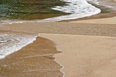 River meets Pacific Ocean Stock Photos