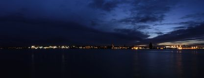 River Mersey and Birkenhead by night - panoramic  view from Keel Wharf waterfront in Liverpool, UK. River Mersey and Birkenhead by night - panoramic  view from Royalty Free Stock Photos
