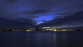 River Mersey and Birkenhead by night. Panoramic view from Keel Wharf waterfront in Liverpool, United Kingdom stock photos