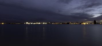 River Mersey and Birkenhead by night. Panoramic view from Keel Wharf waterfront in Liverpool, United Kingdom Stock Photography
