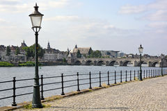 River Meuse in Maastricht Saint Servatius bridge beyond Royalty Free Stock Images