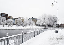 River in the middle of the city on a cold and cloudy winter day Stock Images