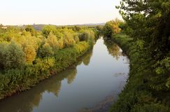 River in the middle of the countryside in Northern Italy Royalty Free Stock Image
