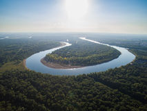 A river in the middle of a forest close to the city. Aerial survey of recreation center Stock Image