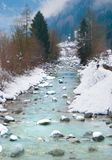 Sarca river with snowy banks. River in the midst of nature around Pinzolo a little town close to Madonna di Campiglio royalty free stock images