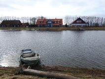 River Minija and ship in village Minge, Lithuania Stock Photography