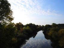 River Minija and beautiful cloudy sky, Lithuania royalty free stock photo