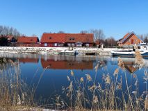 River Minija and village Minge, Lithuania. River Minija and new and old homes in village Minge in spring royalty free stock photography
