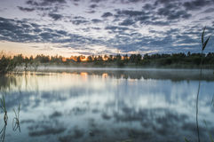 River with mist and sunset Stock Image