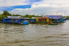 River Mobile Homes in a Southeast Asian Country. Mobile Homes in a River of People Living in a Southeast Asian Country stock photo