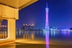 River with modern city landmark architecture backgrounds of pink clouds in Guangzhou China. Zhujiang River and modern building of financial district in stock images