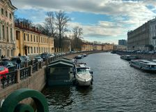 River Moika. The River Moika in St. Petersburg. Quay, dock, pleasure boat, ancient houses, water, clouds Stock Photos