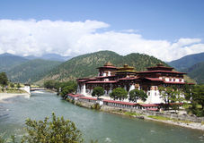 River and Monastery in Bhutan Royalty Free Stock Photography
